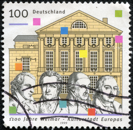 GERMANY- CIRCA 1999  A stamp printed by Germany honoring 1100th Anniversary of Weimar, European City of Culture, shows National Theatre, Schiller, Goethe, Wieland and Herder, circa 1999