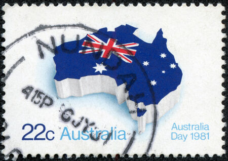 AUSTRALIA - CIRCA 1981  A stamp printed in Australia shows flag of Australia placed in the contour of the continent, circa 1981