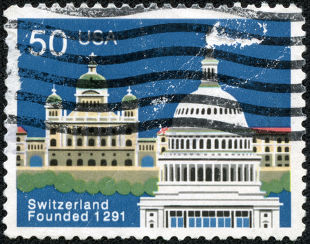 confederation: USA - CIRCA 1991: A stamp printed in USA issued for the 700th anniversary of Swiss Confederation shows Federal Palace, Bern and Capitol, Washington, circa 1991.