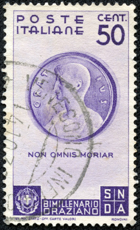 horace: ITALY - CIRCA 1936: A stamp printed in Italy shows Medallion with Horace (Museo di Cracovia), inscript Non omnis morinar - I shall not altogether die, circa 1936 Editorial