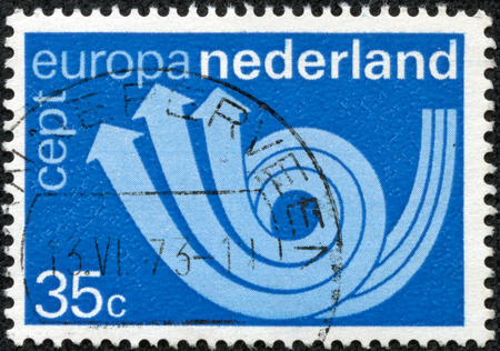 posthorn: NETHERLANDS - CIRCA 1973: A stamp printed in Netherlands shows postal triple horn symbolizing post, telegraph and telephone, circa 1973 Stock Photo