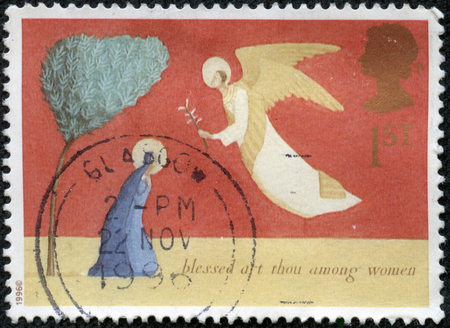 thou: UNITED KINGDOM - CIRCA 1996: A postage stamp printed in the United Kingdom shows Christmas scenery The Annunciation - blessed art thou among women, circa 1996