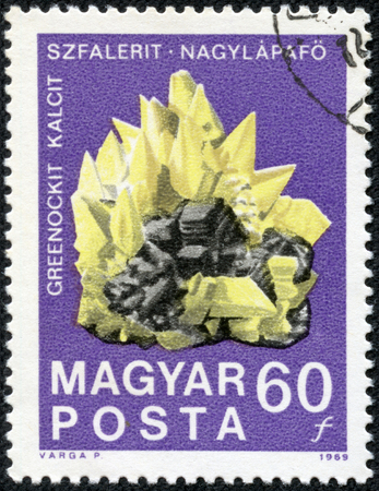 """sphalerite: HUNGARY - CIRCA 1969: A stamp printed in Hungary shows Greenockite calcite sphalerite crystals, with the same inscription, series \\ \ """"Centenary of the Hungarian State Institute of Geology \\\"""", circa 1969"""