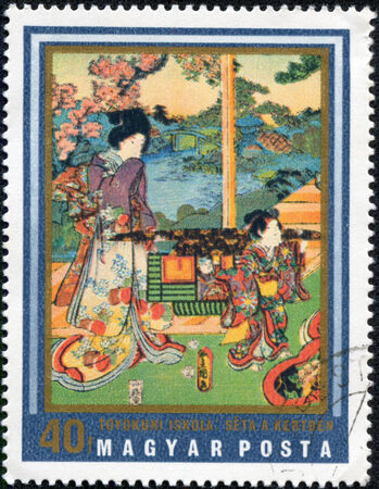 """art museum: HUNGARY - CIRCA 1971: A stamp printed in Hungary shows painting Walking in Garden (Toyokuni School), the same inscription, series  """"Japanese Prints from Museum of East Asian Art, Budapest """", circa 1971"""