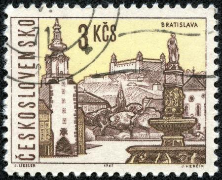 CESKOSLOVENSKO - CIRCA 1965  stamp printed in Czechoslovakia  Czech  shows Bratislava; capital of Slovakia; castle, st  Michaels gate   Roland fountain; views of towns; Scott 1352 A516 3k, circa 1965