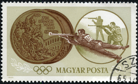 summer olympics: HUNGARY - CIRCA 1965  stamp printed by Hungary, shows two medals, shooting, Summer Olympics in Tokyo, series, circa 1965