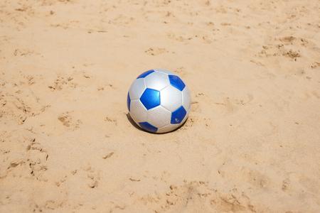 soccer leather ball on beach photo
