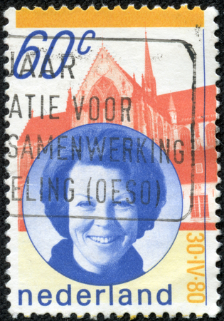 juliana: NETHERLANDS - CIRCA 1980: A stamp printed in the Netherlands issued for the installation of Queen Beatrix shows Queen Beatrix and New Church, Amsterdam, circa 1980.