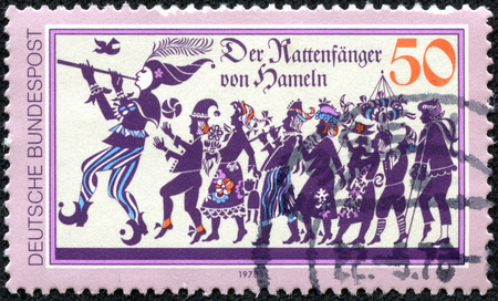 GERMANY - CIRCA 1978: a stamp printed in the Germany shows Pied Piper of Hamelin who led 130 Children of Hamelin Away Never to be Seen Again, circa 1978