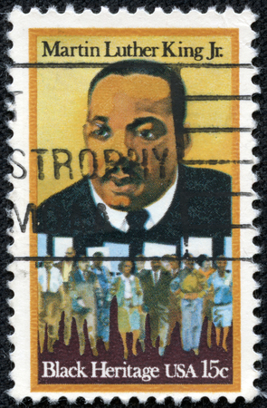 marchers: USA - CIRCA 1979: A stamp printed in United States of America shows Martin Luther King Jr. (1929 - 1968) and civil rights marchers, Black heritage, circa 1979