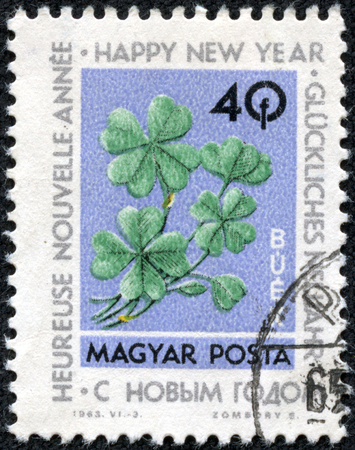 stamp printed by Hungary, shows four-leaf clover, circa 1963 Stock Photo