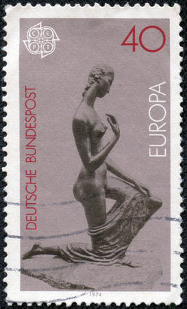 bundespost: GERMANY - CIRCA 1974: A stamp printed in the Germany shows Kneeling Woman, Sculpture by Lehmbruck, circa 1974 Editorial