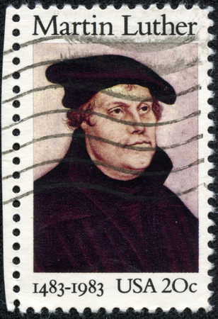 UNITED STATES OF AMERICA - CIRCA 1983: A stamp printed in USA shows image portrait Martin Luther was a German priest and professor of theology who initiated the Protestant Reformation, circa 1983.