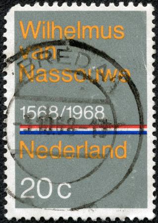 orange nassau: NETHERLANDS - CIRCA 1968: A stamp printed in the Netherlands issued for the 400th anniversary of Dutch National Anthem shows Wilhelmus van Nassouwe, circa 1968. Stock Photo