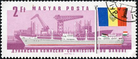 magyar posta: HUNGARY - CIRCA 1967: stamp printed by Hungary, shows ship and flag, circa 1967 Stock Photo