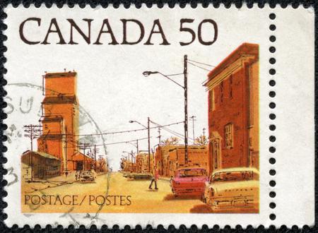 canada stamp: CANADA - CIRCA 1978: a stamp printed in the Canada shows Main Street, Prairie Town, circa 1978