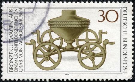 FEDERAL REPUBLIC OF GERMANY - CIRCA 1976: A stamp printed in the Federal Republic of Germany shows Bronzekultwagen aus einem urnenfelderzeitlich en grab von acholshausen, circa 1976