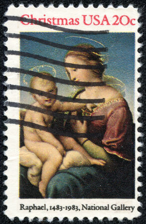UNITED STATES OF AMERICA - CIRCA 1983: A stamp printed in USA shows painting by artist Raphael, Madonna and Child, with the inscription Raphael, National Gallery, from series christmas, circa 1983