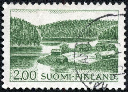 suomi: FINLAND - CIRCA 1964: stamp printed by Finland, shows Farm on Lake Shore, circa 1964