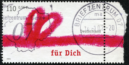 GERMANY - CIRCA 2001: Postage stamp printed in Germany, shows a gift ribbon tied in the shape of a heart and an inscription in German photo