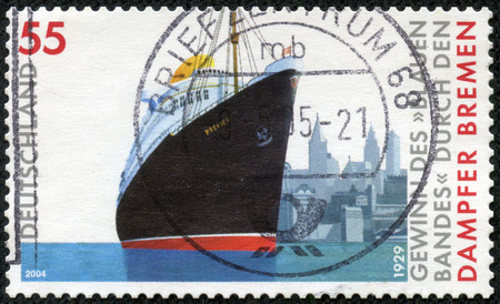 record breaking: GERMANY - CIRCA 2004: a stamp printed in the Germany shows Transatlantic Speed Record, 75th Anniversary of the Breaking Voyage of the Steamship Bremen, circa 2004 Stock Photo