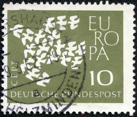 GERMANY - CIRCA 1961: Postage stamp printed in Germany, shows 19 pigeons, arranged as a flying Dove, circa 1961 Stock Photo