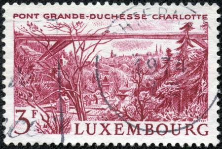 LUXEMBOURG - CIRCA 1966: A stamp printed in Luxembourg, shows Grand Duchess Charlotte Bridge with the same inscription and name of series, circa 1966 photo