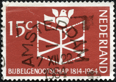 nederlan: NETHERLANDS - CIRCA 1964: a stamp printed in the Netherlands shows Bible, Chrismon and Dove, 150th Anniversary of the Founding of the Netherlands Bible Society, circa 1964