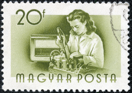 the assembler: HUNGARY - CIRCA 1955 : A stamp printed in Hungary shows Radio assembler, without inscription, from the series Hungary Workers, circa 1955