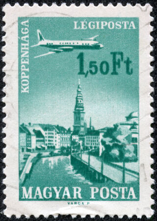 magyar: HUNGARY - CIRCA 1966: A stamp printed in Hungary from the Plane over Cities served by Hungarian Airways issue shows Copenhagen, circa 1966.
