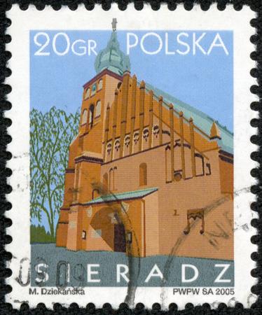 solemnity: POLONIA - CIRCA 2005: Un francobollo stampato in Polonia mostra Sieradz tempio Solennit� di Tutti i Santi, circa 2005