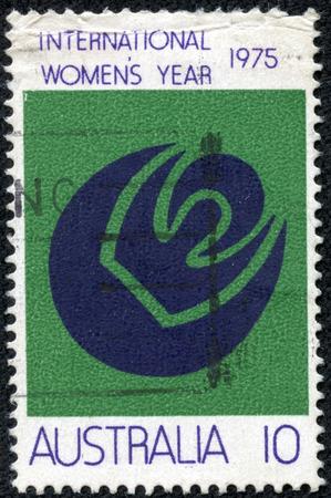 womanhood: AUSTRALIA - CIRCA 1975: a stamp printed in the Australia shows Symbols of Womanhood, Sun, Moon, International Women