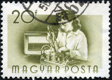 the assembler: HUNGARY - CIRCA 1955 : A stamp printed in Hungary shows Radio assembler, without inscription, from the series \\\Hungary Workers\\\, circa 1955