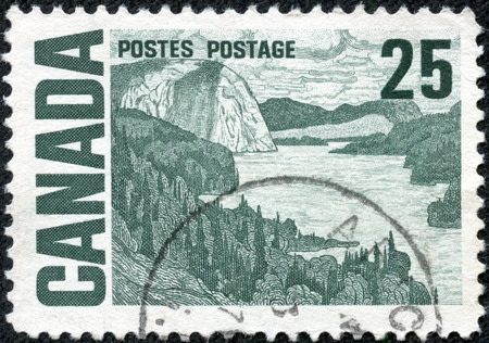 macdonald: CANADA - CIRCA 1967: a stamp printed in the Canada shows The Solemn Land, Oil Painting by J. E. H. MacDonald, circa 1967 Stock Photo
