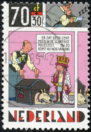 strip a dog: NETHERLANDS - CIRCA 1984: A stamp printed in Netherlands shows Strip Cartoons -The king and money chest, circa 1984