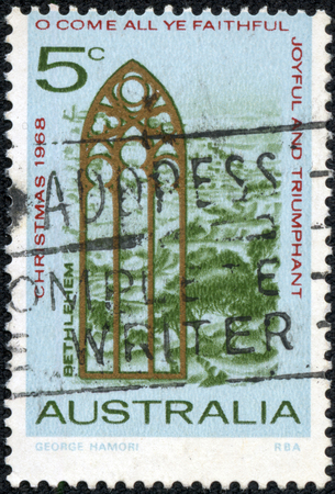 AUSTRALIA - CIRCA 1968: A stamp printed in Australia from the Christmas issue shows Church Window and View of Bethlehem, circa 1968. photo