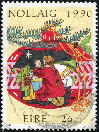 child praying: IRELAND - CIRCA 1990: A stamp printed in Ireland shows Child praying, with the inscription December 1990, from the series Christmast, circa 1990