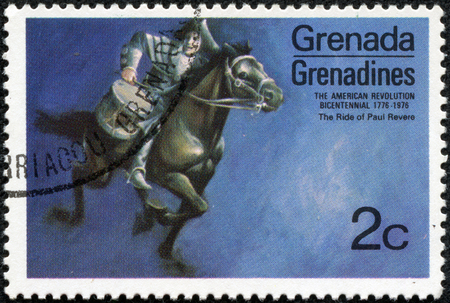 GRENADINES OF GRENADA - CIRCA 1975: A stamp printed in Grenada from the Bicentenary of American Revolution (1976) 1st issue shows Paul Reveres ride, circa 1975.