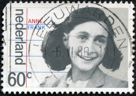 HOLLAND - CIRCA 1980: A stamp printed in The Netherlands shows image of Anne Frank, circa 1980