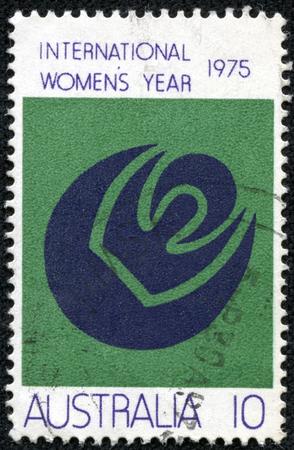 womanhood: AUSTRALIA - CIRCA 1975: a stamp printed in the Australia shows Symbols of Womanhood, Sun, Moon, International Womens Year, circa 1975