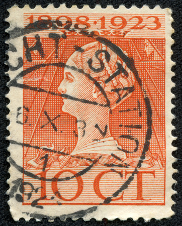 wilhelmina: NETHERLANDS - CIRCA 1923: a stamp printed in the Netherlands shows Queen Wilhelmina, 25th Anniversary of the Assumption as Monarch of the Netherlands, circa 1923