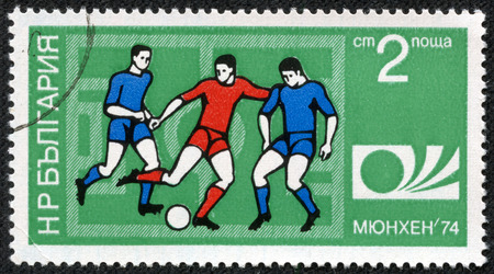 philatelic: BULGARIA - CIRCA 1974: A Stamp printed in BULGARIA shows a football players and Munich
