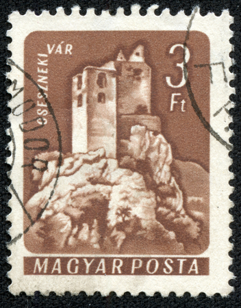 magyar posta: HUNGARY - CIRCA 1960: A stamp printed in Hungary shows Csesznek Castle, with the same inscription. Editorial