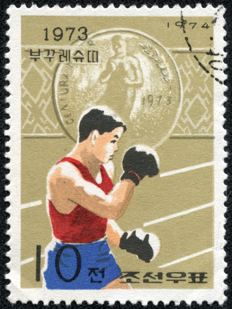 sello: NORTH KOREA - CIRCA 1974: A stamp printed in North Korea from the North Korean Victories at International Sports Meetings issue shows Boxing (Bucharest), circa 1974.