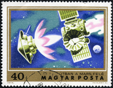 mariner: HUNGARY - CIRCA 1974: A stamp printed in Hungary shows satellite Mariner 4 on course for Mars, with the inscription Course for Mars, from the series Mars Research Projects, circa 1974