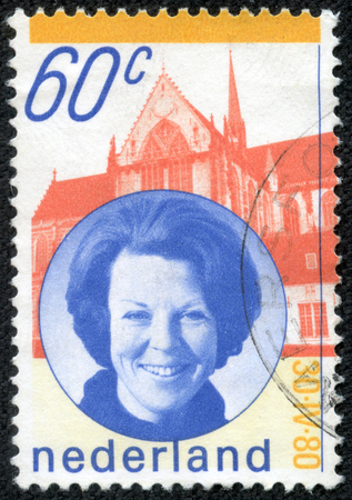 regnant: NETHERLANDS - CIRCA 1980: A stamp printed in the Netherlands issued for the installation of Queen Beatrix shows Queen Beatrix and New Church, Amsterdam, circa 1980.