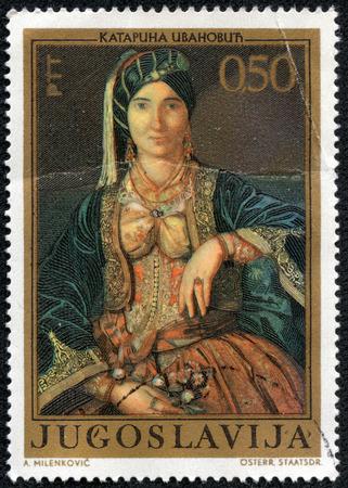 YUGOSLAVIA - CIRCA 1971: a stamp printed in the Yugoslavia shows Woman in Serbian Costume, Painting by Katarina Ivanovic, circa 1971 Editorial