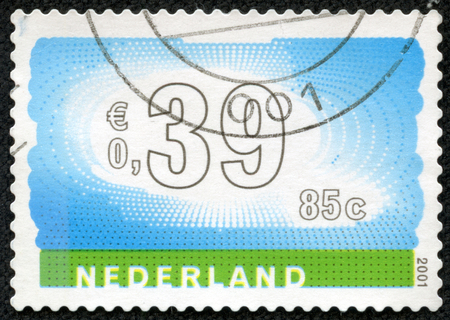 nederlan: NETHERLANDS - CIRCA 2001: Stamp of the Netherlands with an abstract, colour background, circa 2001. Stock Photo