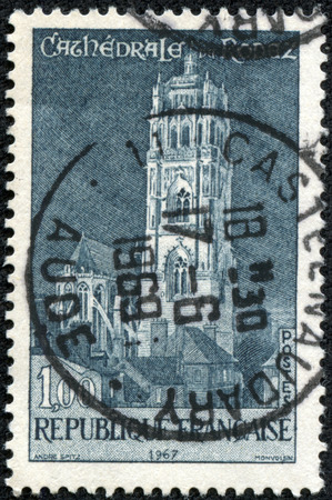 FRANCE - CIRCA 1967: A stamp printed by FRANCE shows view of Roman Catholic Cathedral located in Rodez. Rodez is a town and commune in southern France, in the Aveyron department, circa 1967