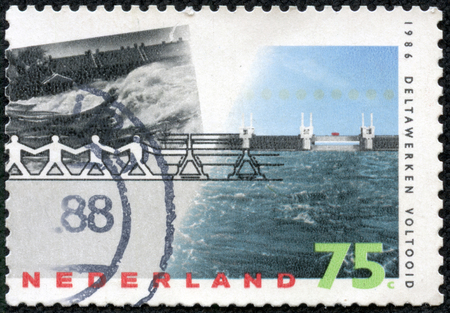 NETHERLANDS - CIRCA 1986: a stamp printed in the Netherlands shows Barrier Withstanding Flood, Delta Project Completion, circa 1986